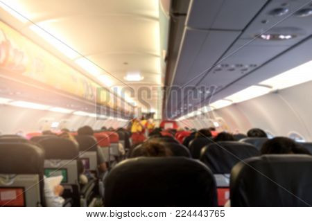 Abstract blur Inside the plane passengers traveling in airplane .