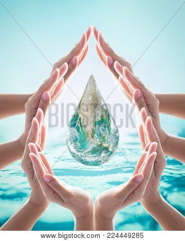 World water day, saving bio natural environment concept with hands in drop water cycle. Element of the image furnished by NASA poster