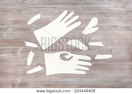 workshop on sewing gloves - top view of paper templates of gloves on wooden table