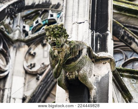 Travel to France - gargoyle sculpture on outdoor wall of Reims Cathedral (Notre-Dame de Reims)