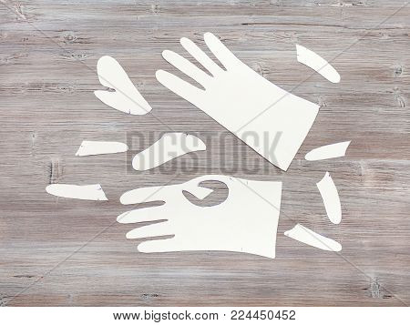 workshop on sewing gloves - top view of paper patterns of gloves on wooden table