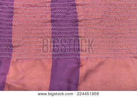 workshop on sewing a patchwork scarf - texture of raw stitched pink silk shawl on table