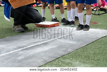 Students Boy Taking Long Jump On The Air During A School Sport Competition Day. School Sports Day Co