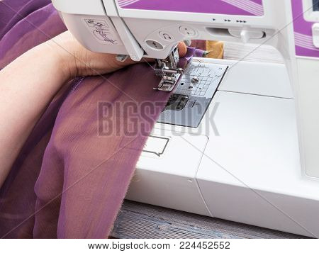 workshop on sewing a patchwork scarf - needlewoman stitches strips of fabrics for the future silk shawl with sewing machine