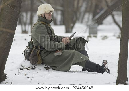 Saint Petersburg, Russia - February 23, 2017: Frozen german soldier of the Wehrmacht  on duty. Historical reenactment of Second World War.