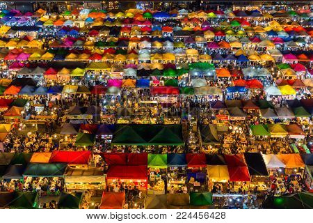 High view of colorful tent retail shop with night light at Talad Rod Fai Night Market, Ratchada, Bangkok, Thailand