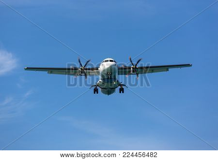 Passenger propeller airplane in the sky before landing