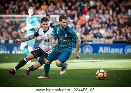 VALENCIA, SPAIN - JANUARY 27: NAcho with ball during Spanish La Liga match between Valencia CF and Real Madrid at Mestalla Stadium on January 27, 2018 in Valencia, Spain