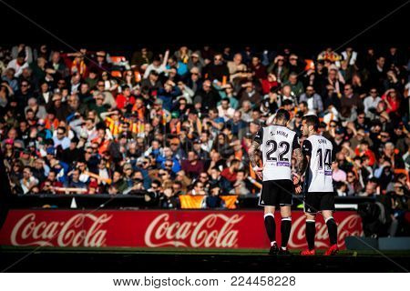VALENCIA, SPAIN - JANUARY 27: Mina and Gaya during Spanish La Liga match between Valencia CF and Real Madrid at Mestalla Stadium on January 27, 2018 in Valencia, Spain