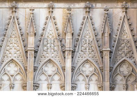 Close-up view to the symmetrical architectural stone details of the Barcelona's gothic Cathedral, also known as La Seu. Located in the heart of Barcelona's Gothic Quarter.