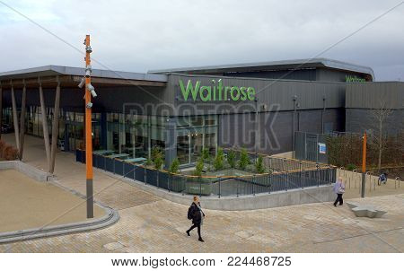Bracknell, England - January 31, 2018: People passing by the Waitrose supermarket store, part of the new Lexicon shopping center in Bracknell, England