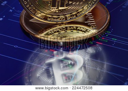 Bitcoin. Crypto currency Bitcoin, BTC, Bit Coin. Bitcoin and Ethereum golden coins reflection in monitor with a chart. Blockchain technology, bitcoin mining concept