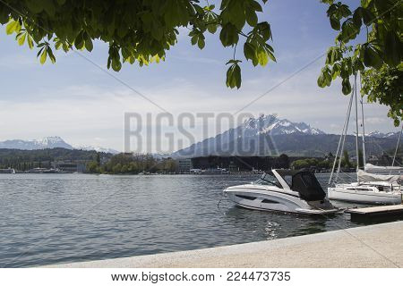 Lucerne is a city in central Switzerland. Tourist go to mount Rigi by boat on lake Lucerne. A panoramic view of the snow-capped Swiss Alps from the old part of Lucerne
