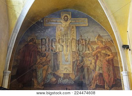 ZAGREB, CROATIA - AUGUST 19, 2016: Christ is crucified with evangelists and Saints Fabian, Sebastian, Florian, Roch and Blessed Augustine Kazotic, fresco in the church of St. Mark in Zagreb, Croatia