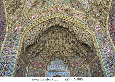 SHIRAZ, IRAN - JUNE 20, 2007: Beautiful old mosaic decorating exterior wall of the Nasir al-Mulk mosque in Shiraz, Iran.