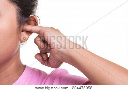 Close Up Woman Trying Cleaning Her Ear By Using Her Finger Isolated On White