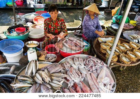My Tho, Vietnam - February 15: Woman Sells Fish And Seafood On Street Market On February 15, 2012 In