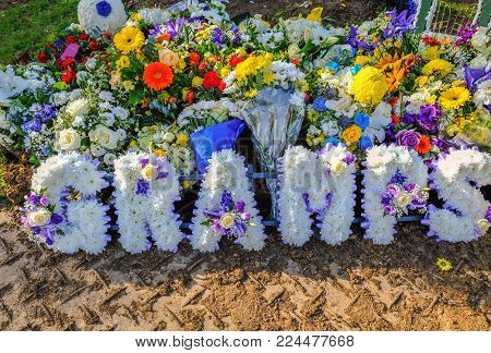 Welling, Kent, England - October 27, 2017:  Floral tribute to a Grandfather, flowers in the name of Gramps.