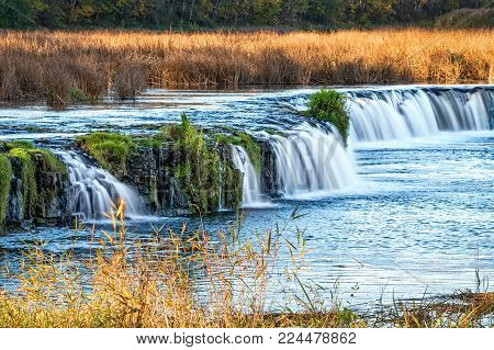 View of latvian Ventas Rumba waterfall in sunset rays. It is the widest waterfall in Europe.