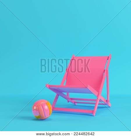 Pink beach chair with volleyball ball on bright blue background in pastel colors. Minimalism concept. 3d render