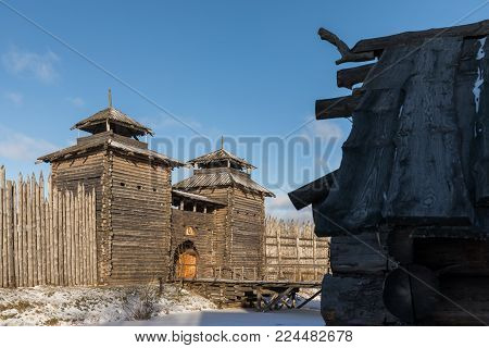Ancient Wooden Fortress And Log Huts. Russian Village In The Winter. Russia. Suzdal.