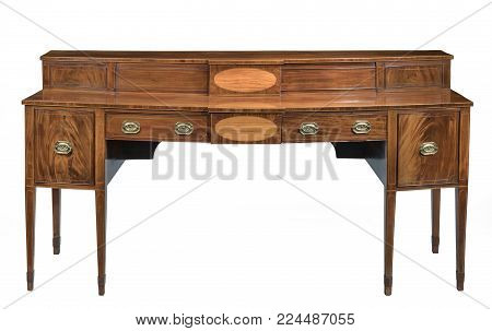 Antique bow fronted mahogany dining room sideboard serving table with brass handles isolated on white with clipping path