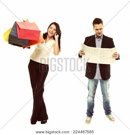 Stereotype of gender. Businessman reading economic newspaper and girl with colorful shopping bags talking on phone isolated. Modern man and woman. Studio shot.