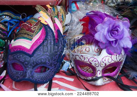 group of colorful carnival masks. A mask is an object normally worn on the face, typically for protection, disguise, performance, or entertainment.