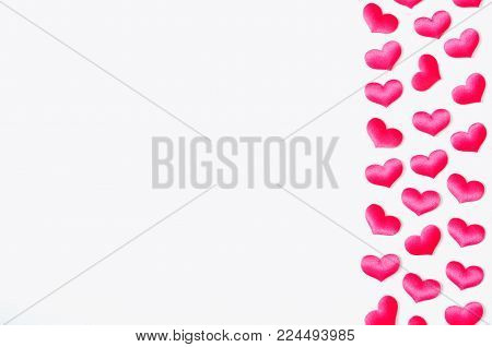St Valentines day background. Pink textile hearts on the white wooden background, free space for text, St Valentines day concept with free space for text for St Valentine's Day message