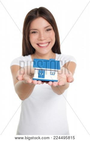 Home owner of first house holding small house toy on hands for real estate mortgage, loan, insurance concept.