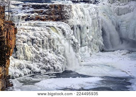 Ausable Chasm falls in late winter in Adirondack