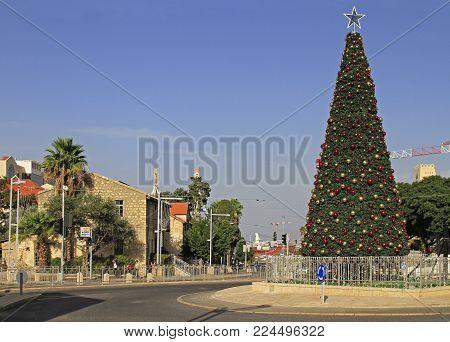 Haifa, Israel - November 27, 2017: people are walking at christmas tree outdoors in city Haifa, Israel