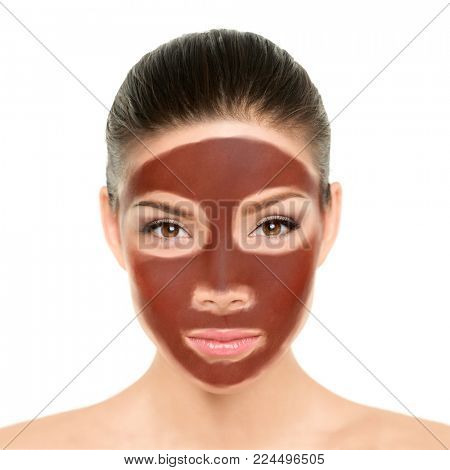Chocolate mask woman putting diy homemade cocoa past or natural clay mud on face for facial treatment. Asian beauty woman with brown exfoliation cream for anti aging cleaning.