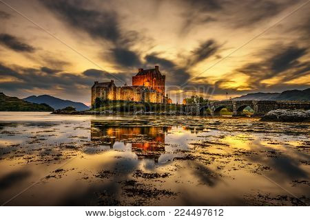 Sunset over Eilean Donan Castle, Scotland, United Kingdom. Long exposure.