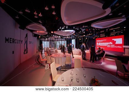 MOSCOW, RUSSIA - OCT 31, 2017: People walk in Mercury Space hall during pause in annual conference of Kommersant Publishing House on e-commerce, online sales and multichannel networks.