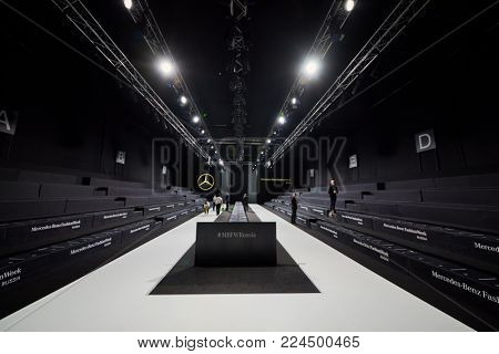 MOSCOW, RUSSIA - OCT 24, 2017: Personnel cleans auditorium after performance during Mercedes Benz Fashion Week Russia spring-summer 2018 day four.