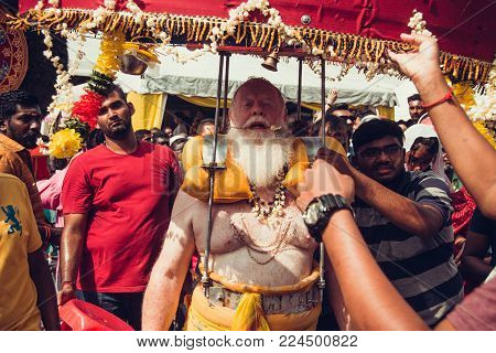 BATU CAVES, SELANGOR, MALAYSIA - 31 JANUARY 2018 Hindu devotees celebrate Thaipusam festival with procession and offerings. Senior man portrait. Religion concept. Culture and traditions. Asia travel
