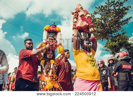 BATU CAVES, SELANGOR, MALAYSIA - 31 JANUARY 2018 Hindu devotees celebrate Thaipusam festival with procession and offerings. People portrait. Culture and traditions. Asia travel. Support concept