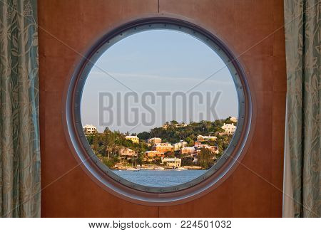 Bermuda coastline seen through a cruise ship porthole