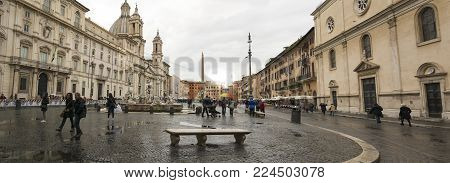 Rome, Italy, march 2015: panoramic view of the famous Piazza Navona with people on a rainy day in Rome, Italy