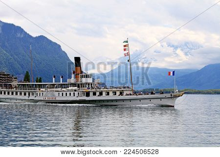 MONTREUX, SWITZERLAND - MAY 09, 2013: Cruise boat La Suisse on Lake Geneva (Lac Leman) in Montreux, Switzerland. Paddle steamer La Suisse built in 1910.