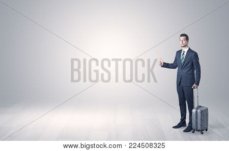 Lonely businessman hitchhikes concept with copy space around him