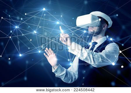 Businessman in virtual reality goggles investigate global network connectivity concept