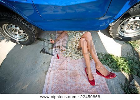 Vintage Girl With Tools Under Car