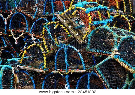 Close-up of pile of colourful crab baskets. poster