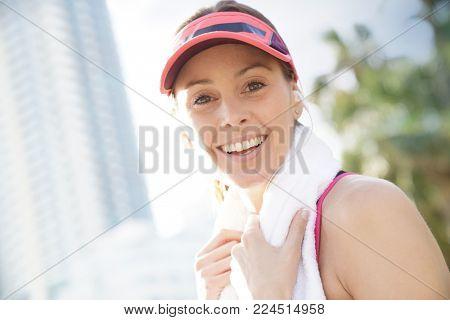 Portrait of smiling jogger woman
