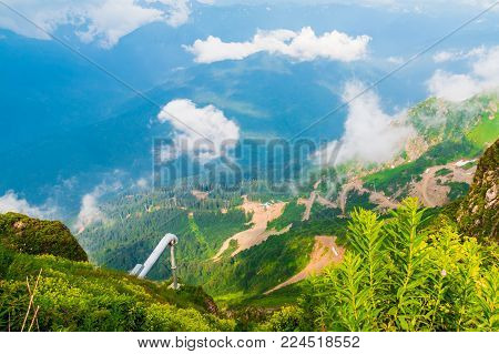 Aerial view of mountains, clouds and valley from the top of mountain in Rosa Khutor, Russia