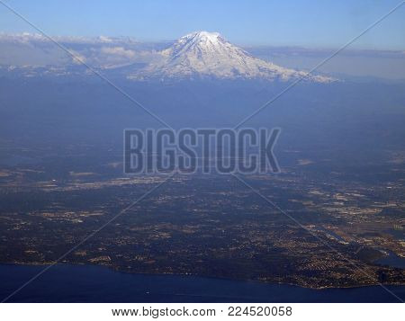 Aerial view Seattle with coast and Mount Rainier visible on June 26, 2016 in Seattle, WA.