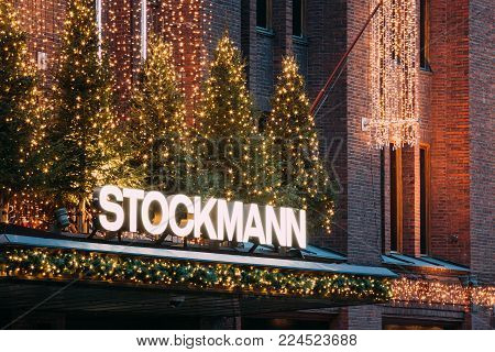 Helsinki, Finland - December 11, 2016: Sign Signboard Title Logotype Of Stockmann Department Store In Evening Christmas Xmas New Year Festive Illuminations. Finnish Company Of Retail Trade