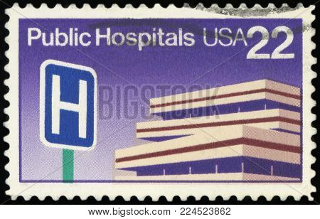 UNITED STATES OF AMERICA - CIRCA 1986: Postage stamp printed in United State of America with image of a Public Hospital symbol with a hospital building.